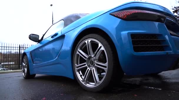 Moscow, Russia - 10 12 2019: New russian model car roadster crimea blue color on the street. Roadster Krim footage on the road. Side view.