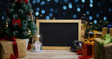 Blackboard Between Christmas Decoration. Copy Space