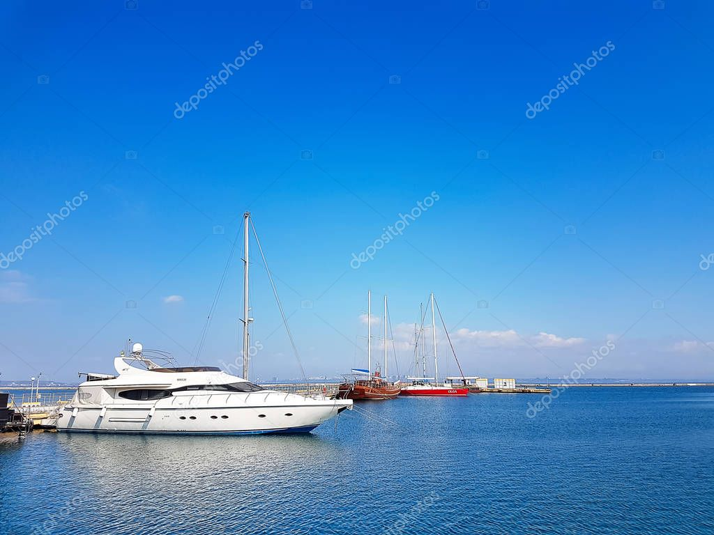 Odessa, Ukraine. 15.03. 2019 Sea port. Beautiful white motor yachts in the sea port