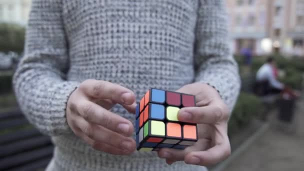 Male hands shows focus with Rubiks cube. How to solve the Rubiks cube. Illusionist shows focus. Focus with Rubiks cube.