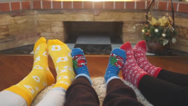 Feet in bright socks at home. Family with kid relaxing on the weekend together.