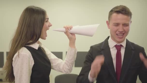 video of Nervous young girl in formal yelling at businessman in office, Conflict situation