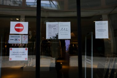 A poster advising customers to practise social distancing while shopping at entrance of  retail shop during covid-19 outbreak in Brussels, Belgium, on April 29, 2020