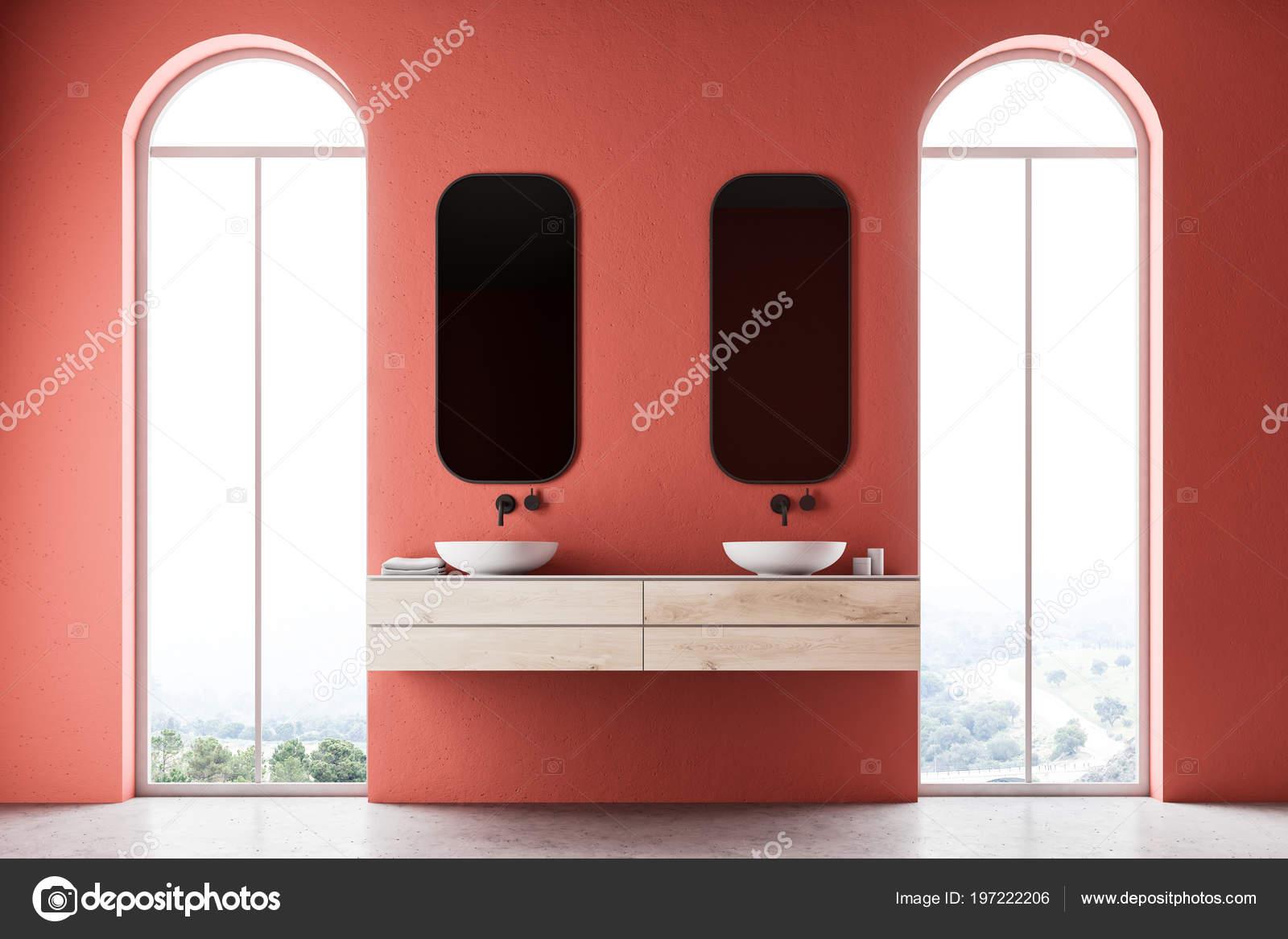 Minimalistische rode badkamer interieur met een dubbele wastafel met