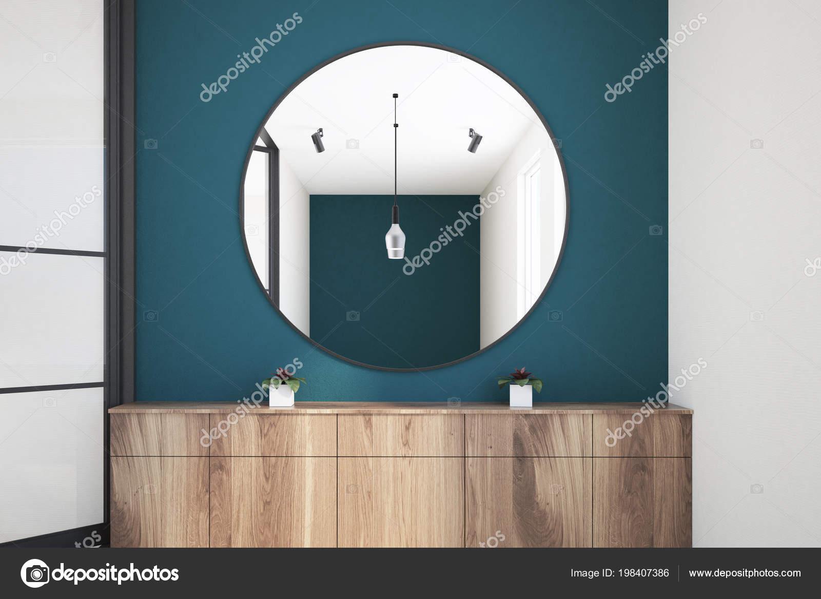 Runder Spiegel Uber Eine Holzerne Kommode Einem Blau Grune Wand