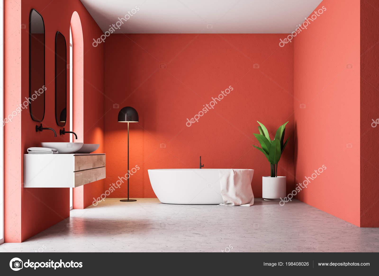 Vasca Da Bagno Rossa : Interno bagno rosso minimalista con una vasca bagno bianca