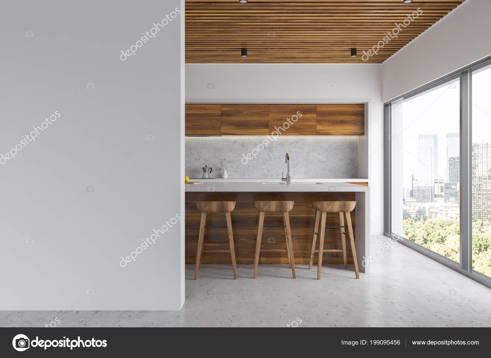 intérieur cuisine blanc avec plancher béton des comptoirs bois avec