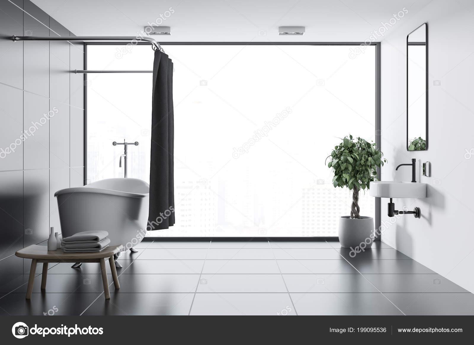 Bagno rivestito piastrelle nere con pavimento piastrelle nere una