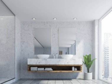 Bathroom interior with marble walls, a double sink standing on white countertops and a two vertical mirrors hanging above it. 3d rendering