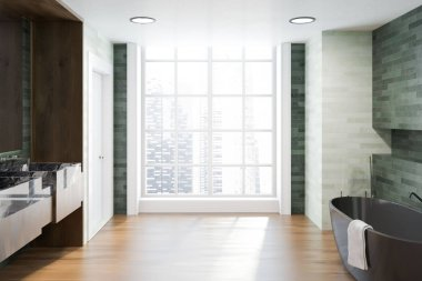 Luxury bathroom interior with emerald and white walls, a wooden floor, a black marble and wooden sink. A black bathtub to to the right of a large window. 3d rendering