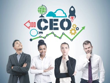 Diverse business team members standing in a row. A gray wall background with a CEO sketch and start up icons on it