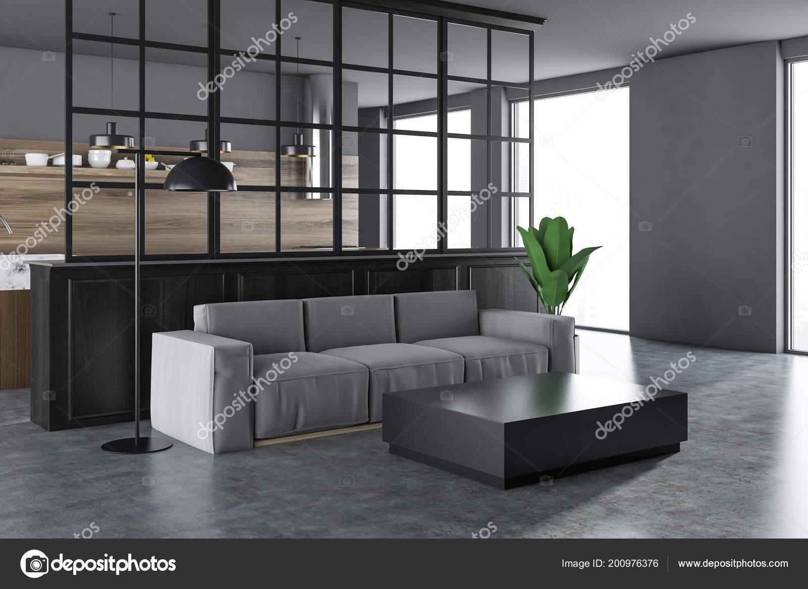 Witte zwarte woonkamer hoek met een grijze vloer een lang
