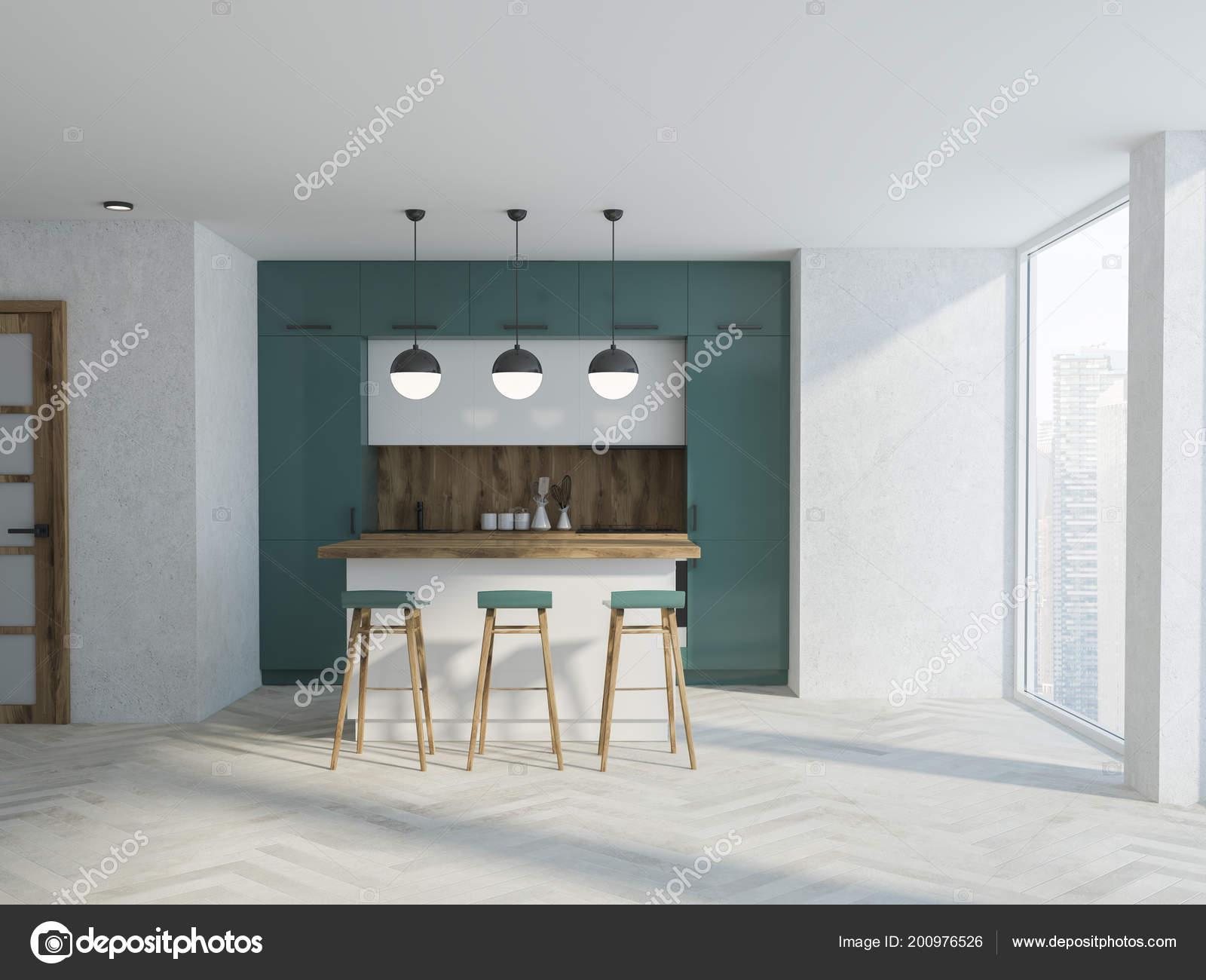 Interiore della cucina legno bianco verde con pavimento cemento