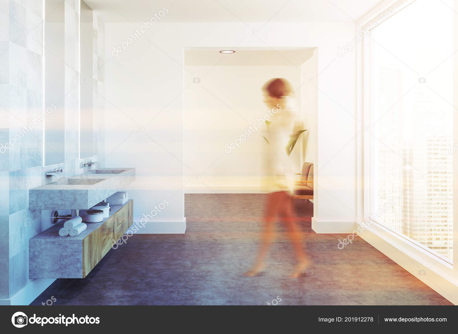 Woman in a hite tile spacious luxury bathroom interior with a concrete floor, a wooden double vessel sink and two narrow mirrors hanging above it.