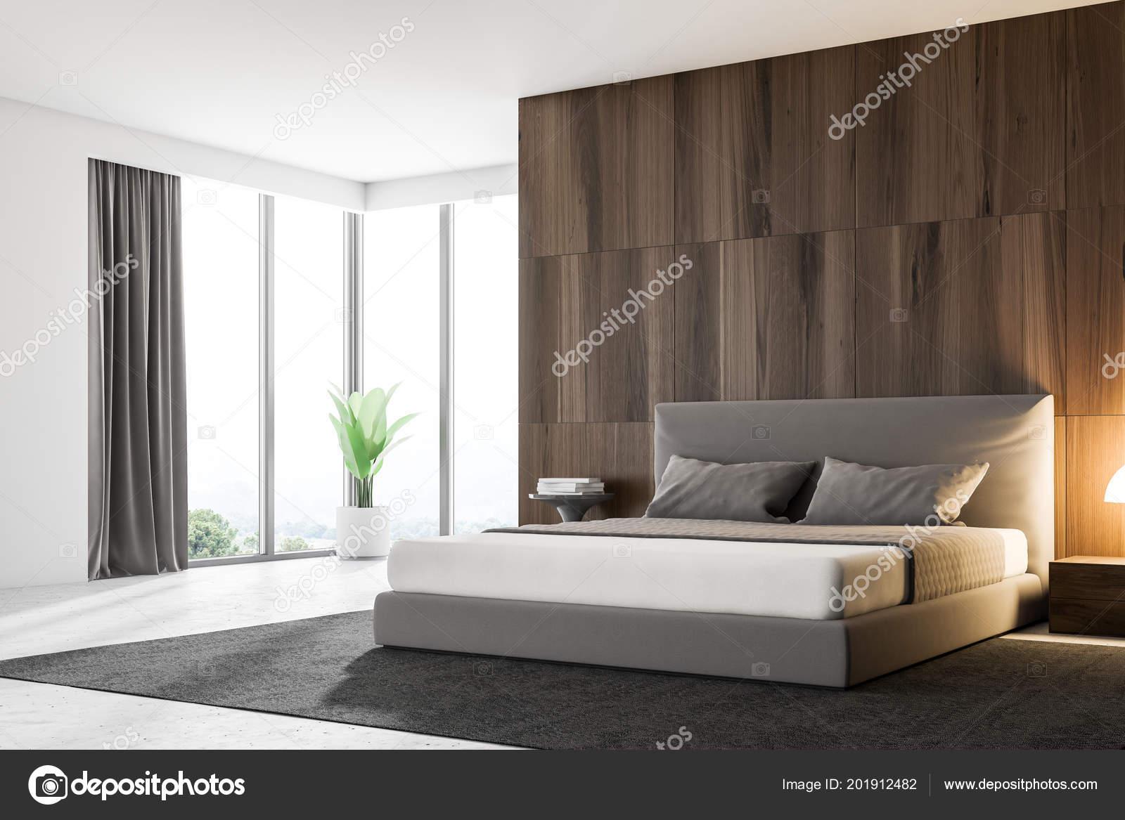 Esquina del dormitorio principal con paredes madera oscuras cama principal foto de stock - Foto chambre a coucher ...