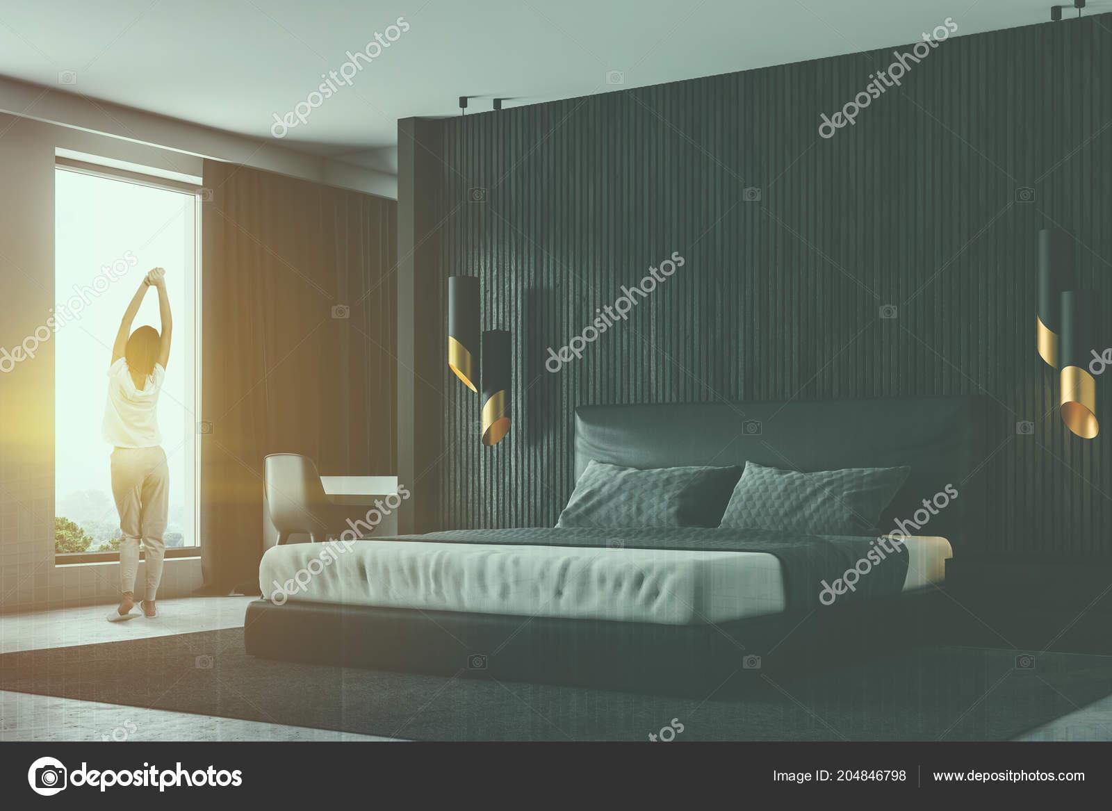 Woman Black Wood Walls Master Bedroom Corner Concrete Floor