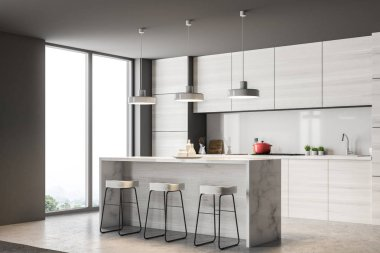 Gray kitchen corner with a bar and loft windows. A concrete floor and gray walls. 3d rendering mock up