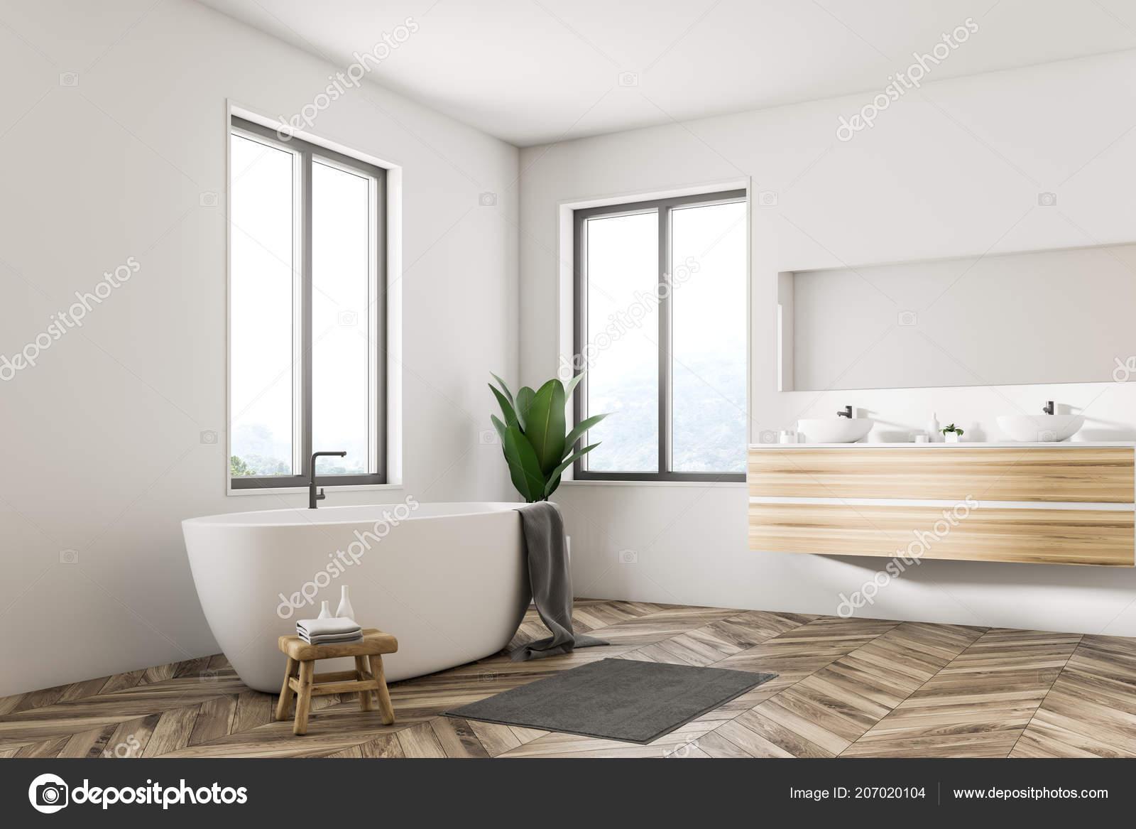 Angolo interni bagno scandinavo con pareti bianche pavimenti legno