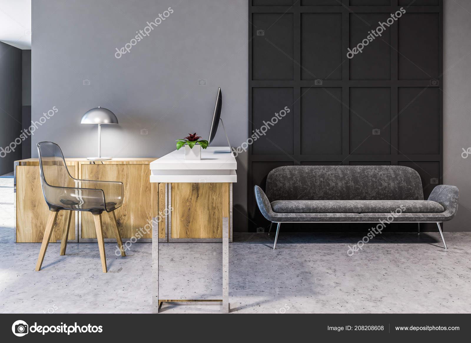 Confortable canapé gris debout sur sol béton bureau domicile style
