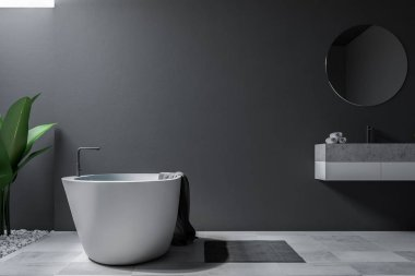 Large bathroom interior with grey walls, a tiled floor, a sink with round mirror and a bathtub. 3d rendering mock up