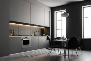 Stylish kitchen interior with white walls, a concrete floor and gray countertops and closets. A table with chairs Side view. 3d rendering mock up
