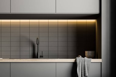 Close up of a kitchen sink built into gray countertops in a white tile kitchen interior. 3d rendering mock up