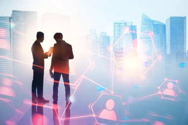 Two businessmen talking. Silhouettes over a blue city background with human resources network immersive interface. Global world. Toned image double exposure mock up