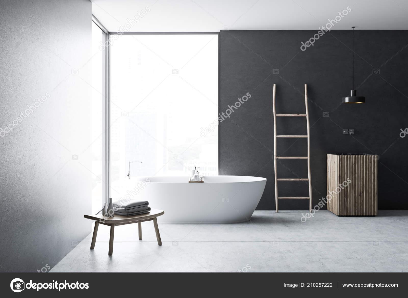 moderne graue wand badezimmer interieur mit betonboden loft fenster leiter holz waschbecken und badewanne wellness hotel und luxus immobilien