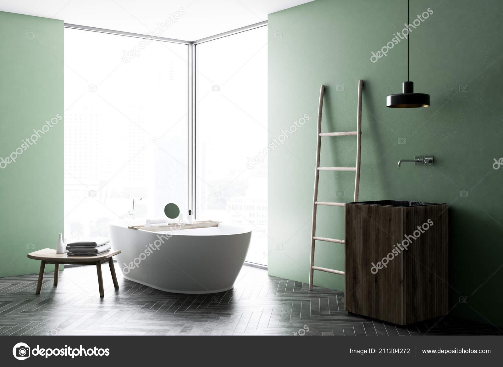 Angolo bagno moderno parete verde con pavimento legno finestra