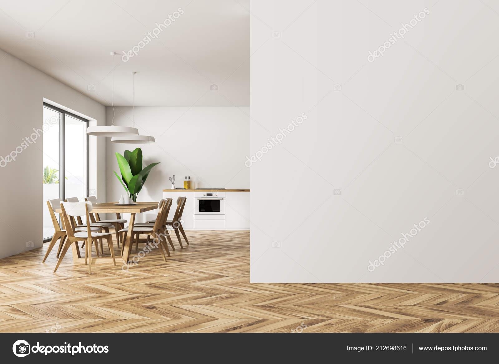 Interieur van moderne eetkamer keuken met witte muren houten vloer