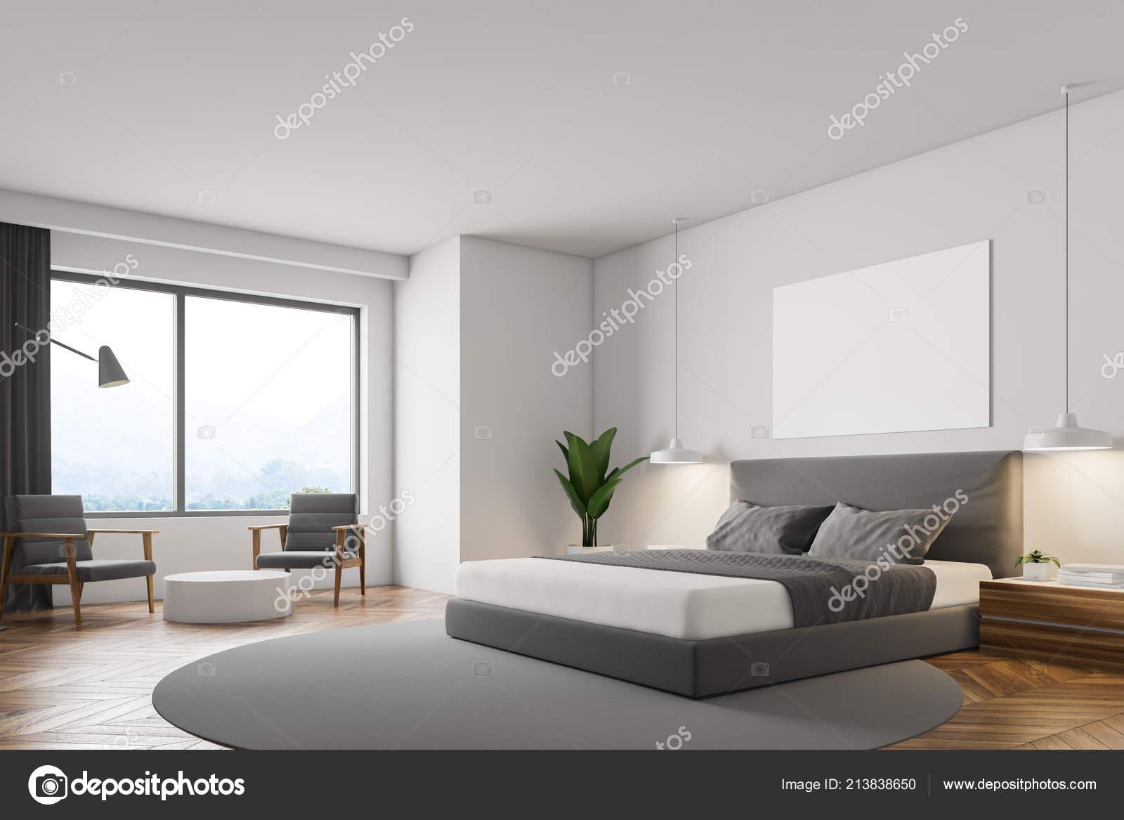 Weiße minimalistisch schlafzimmer mit holzboden runder teppich mit