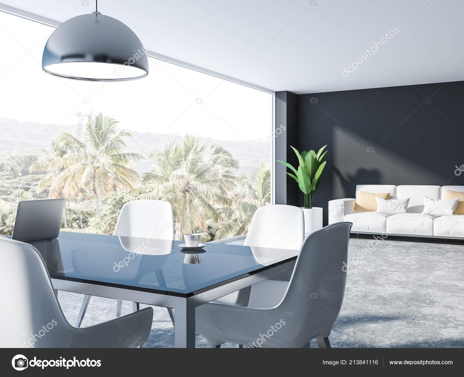 Interieur van eetkamer met grijze muren betonnen vloer glazen
