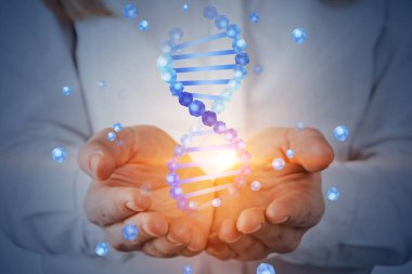 Unrecognizable woman with blond hair holding blue dna helix hologram. Biotech, biology, medicine and science concept. Double exposure toned image