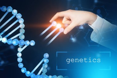 Man hand taking genes from blue dna helix over blue background. Text genetics in bottom. Biotech, biology, medicine and science concept. Double exposure toned image