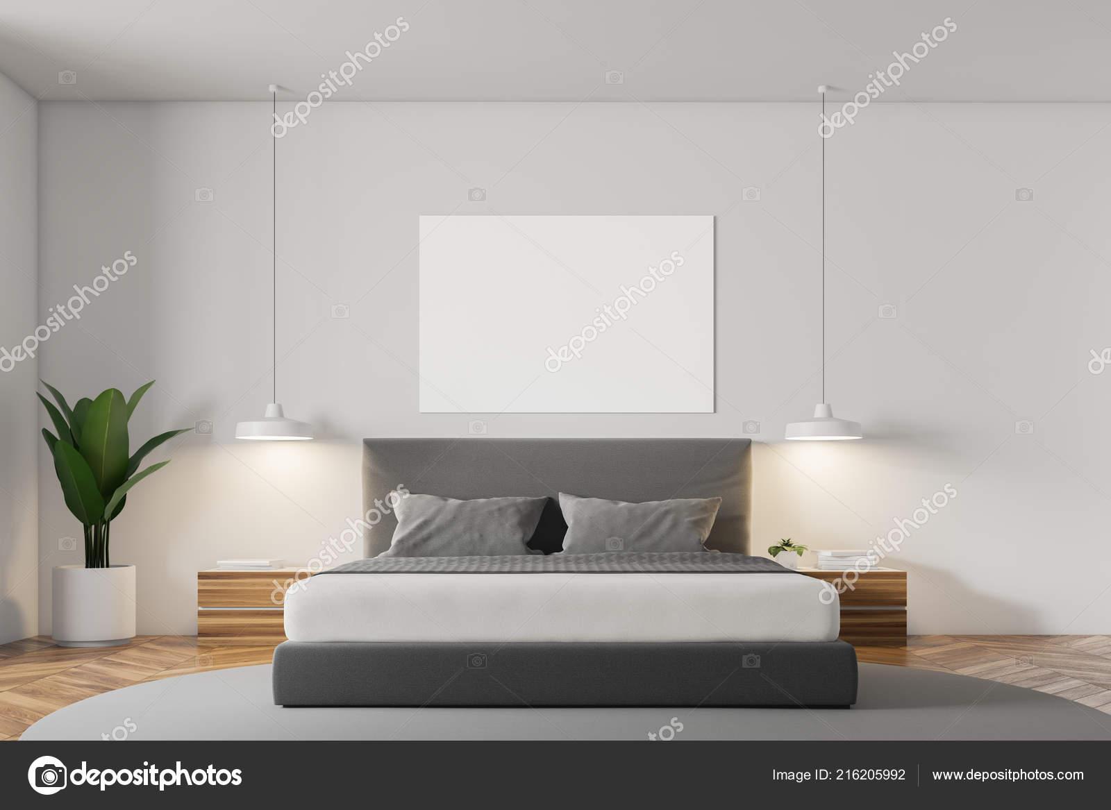 Witte muur minimalistische slaapkamer interieur met een houten vloer
