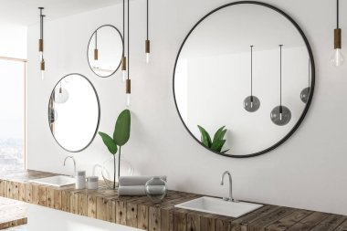 Double sink in wooden countertop in white bathroom interior with three round mirrors and panoramic window. Side view. 3d rendering