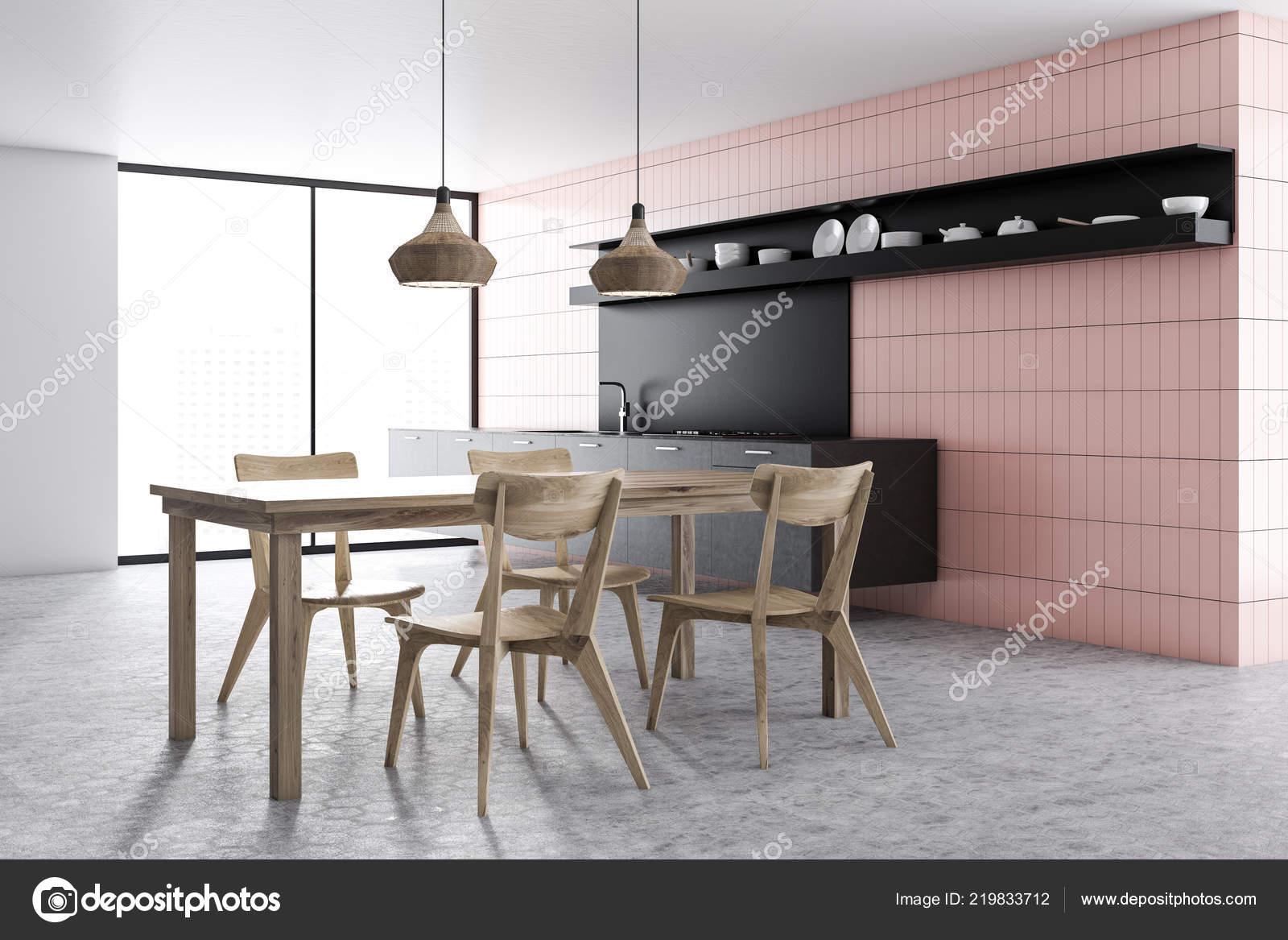 Interiore della cucina moderna con piastrelle rosa pareti