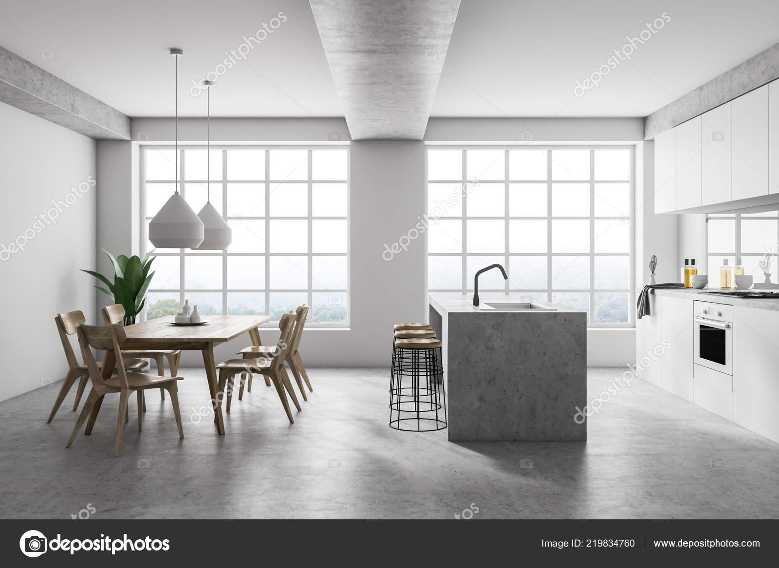 Interieur van moderne keuken met witte muren met betonnen vloer