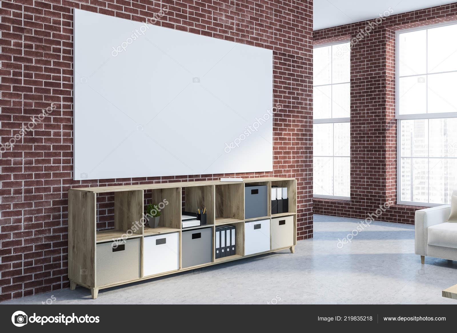 Pareti Beige E Grigio : Angolo del salone moderno con pareti mattoni pavimento cemento