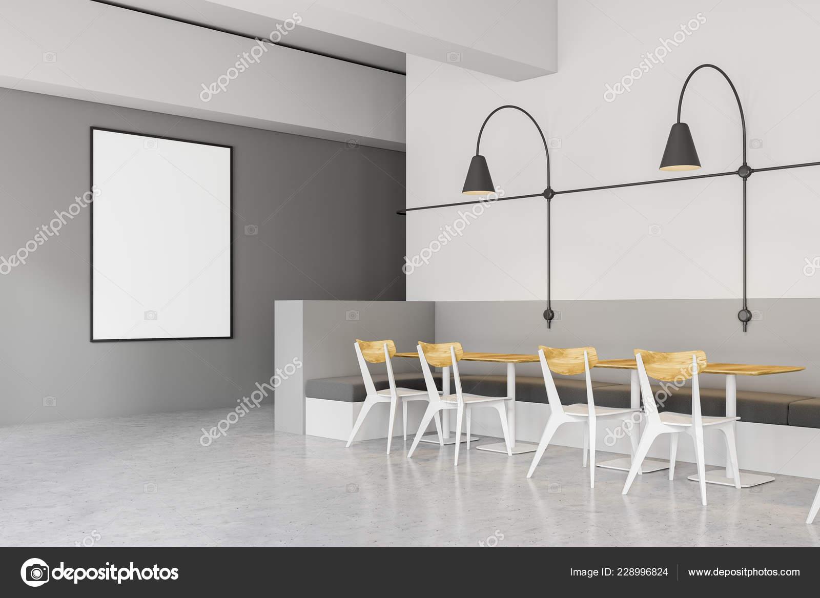 6d3d0825e8fa Esquina de la cafetería moderna con paredes gris y blanco, piso de  concreto, blancos y madera sillas y sofás grises cerca de mesas de madera y  lámparas de ...