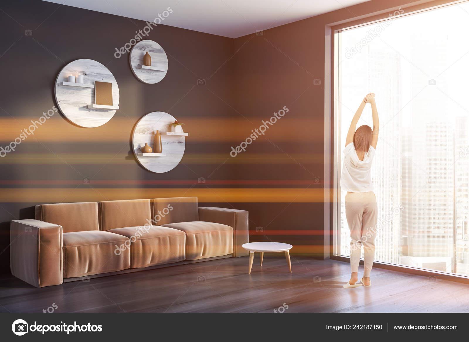 Woman Corner Living Room Gray Walls Black Wooden Floor