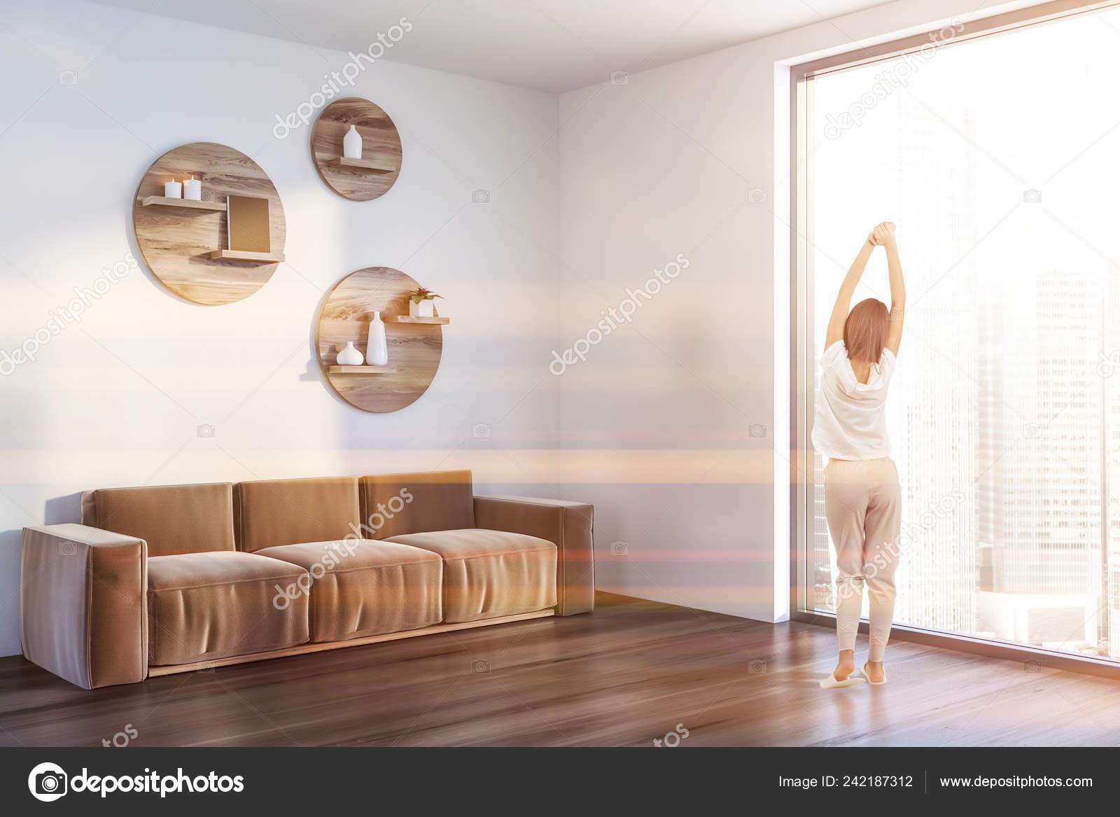 Woman Corner Living Room White Walls Dark Wooden Floor