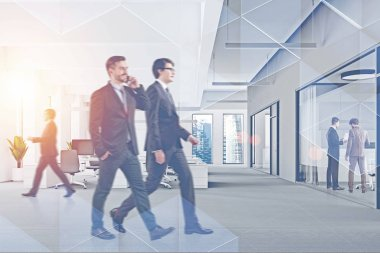 Business people walking and communicating in modern office with double exposure of triangular pattern. Concept of corporate lifestyle. Toned image blurred