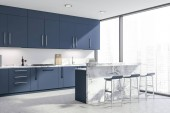 Fotografia Dark blue kitchen corner with bar