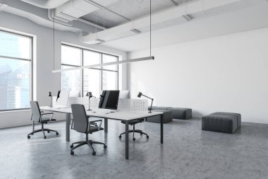 White industrial style office with lounge