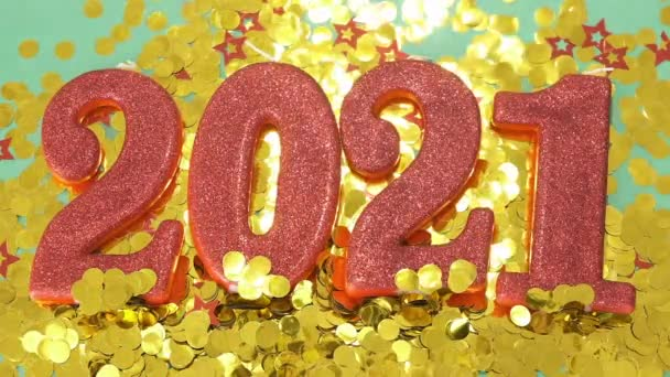 Happy New Year 2021. Red digits 2021 with glitter and xmas decorations nearby. Holiday Party Decoration or postcard concept with top view and copy space, flatly.