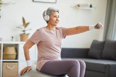 Senior woman exercising at home
