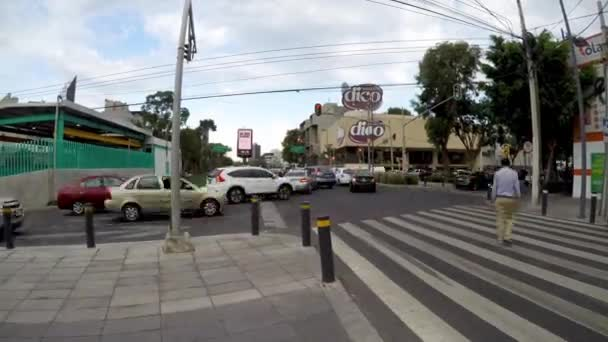 Mexico City, Mexico-June 2019: Timelapse, crossing of people and cars, in Mexico City traffic jams are common in some important avenues.