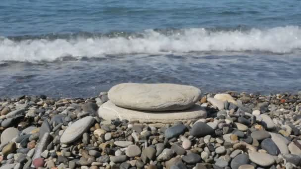 Build a pyramid of stones on the beach