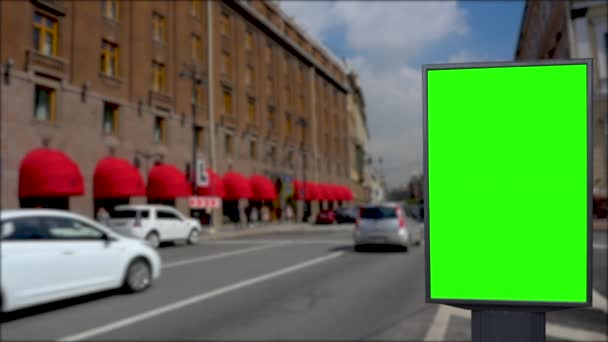 Billboard green screen on the streets of the city